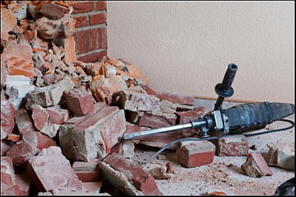 hammer drill lying on a lot of rubble
